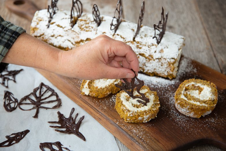 putting on leaves for the pumpkin almond roll
