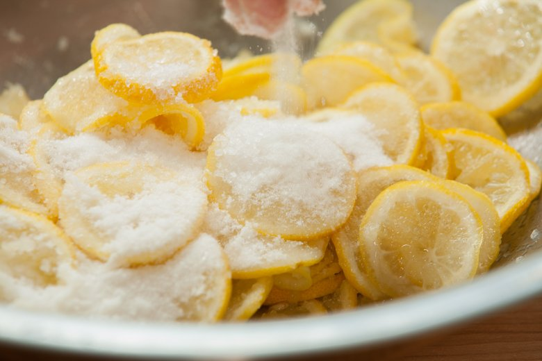 Add salt and sugar to preserve lemons